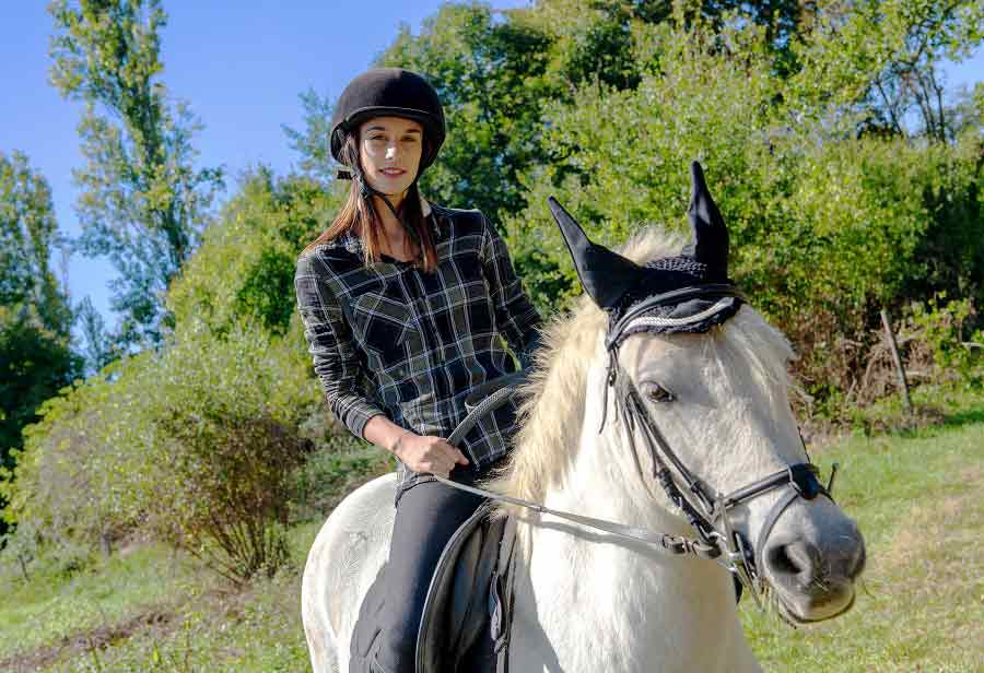 amateur female rider works with her horse