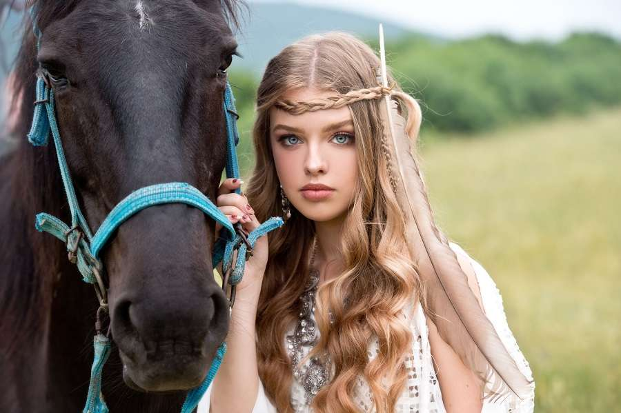 beautiful girl with horse and braided hair